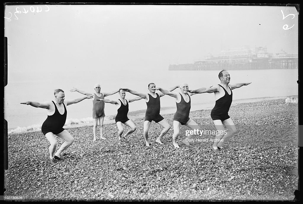 Men exercising on Brighton Beach, 1933. A photograph of a group of men in swimsuits exercising near the West Pier on Brighton Beach, taken by James Jarche for the Daily Herald newspaper on 4 September, 1933. The men are all delegates at the annual Trades Union Congress (TUC) conference.