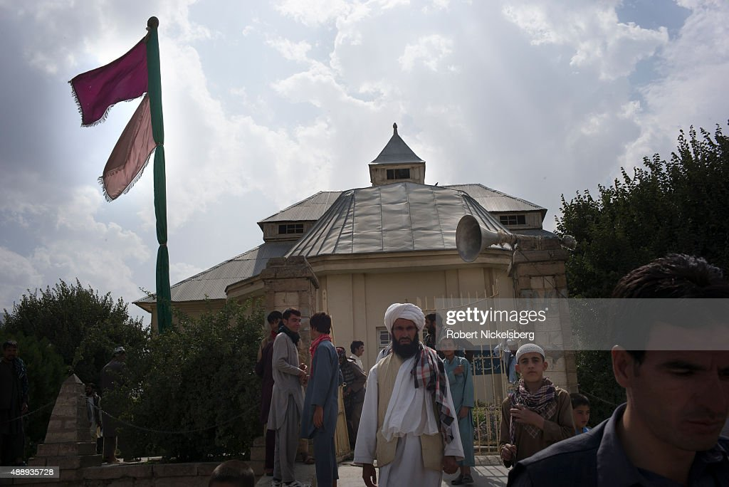 Men exit the Shah Agha shrine September 4, 2015 following the traditional Friday prayers in Kabul, Afghanistan.