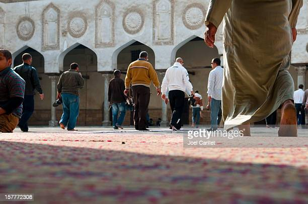 men in a mosque - arab feet stock photos and pictures
