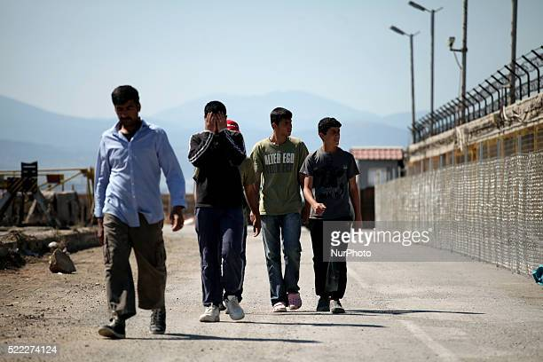 Men exiting the camp Refugee camp in Skaramaga area a port town 11 km west of Athens A large camp is being constructed here with a big capacity and...