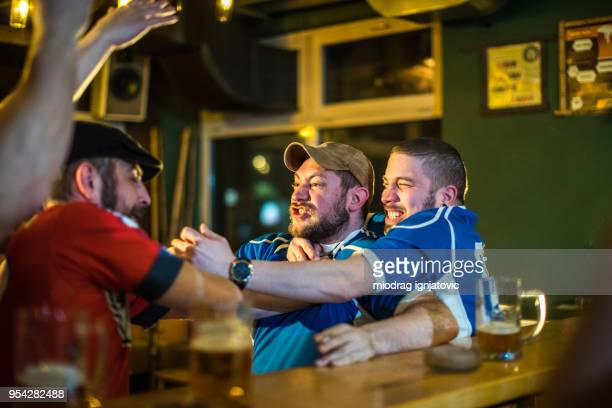 Men fighting in a pub