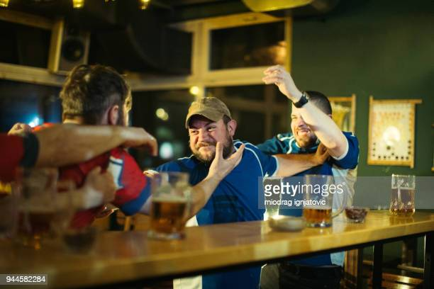 men fighting in pub - fight stock photos and pictures