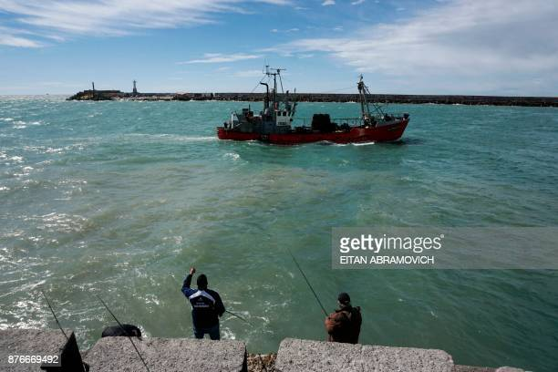 Men fish at the north hatchway of Argentina's Navy base in Mar del Plata on the Atlantic coast south of Buenos Aires on November 20 2017 Argentina's...
