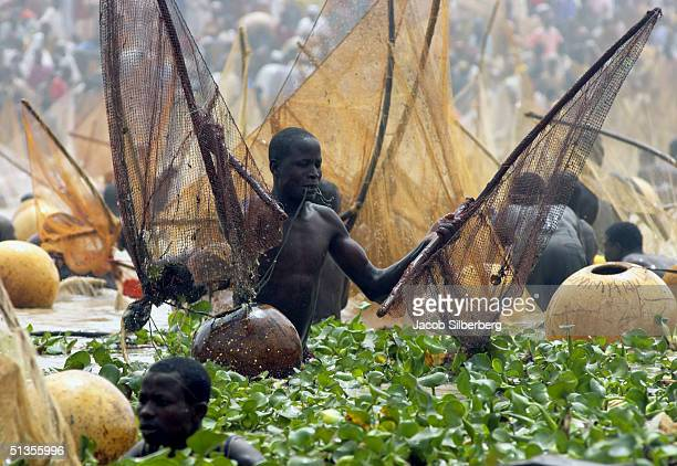 30000 men fish with traditional nets during the Argungu Fishing Festival on March 19 in Argungu Nigeria The Argungu Fishing Festival was first held...