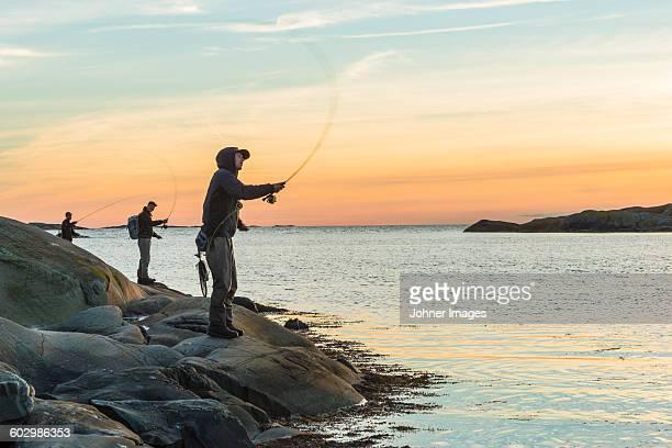 Men fishing at sea