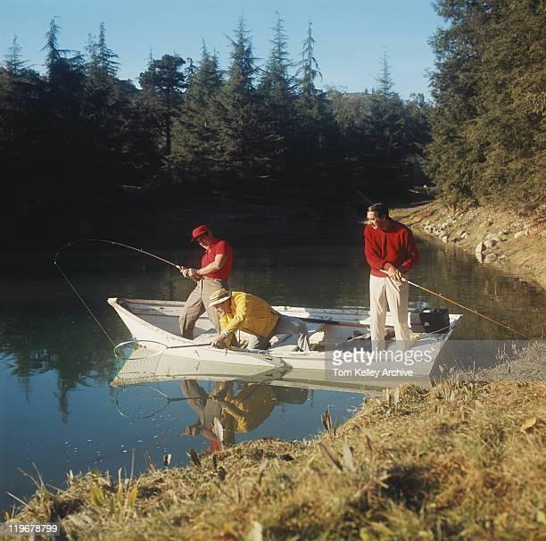 Men fishing in lake