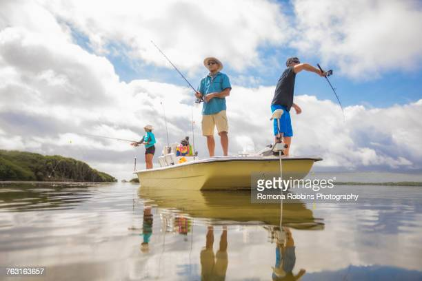 Men fishing in the Gulf of Mexico, Homosassa, Florida, US