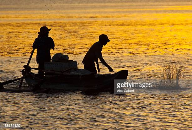 men fishing on a lake in bundala national park. - alex saberi photos et images de collection