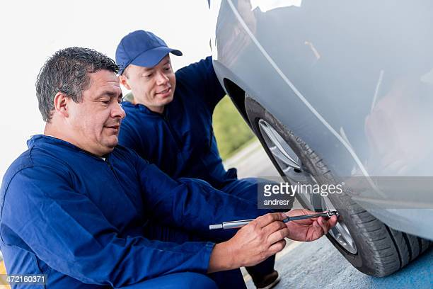 men fixing a flat tire - inflation stock photos and pictures