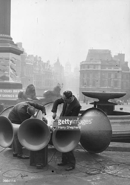 Men fixing the loudspeakers in Trafalgar Square London in readiness for the King's VEday speech