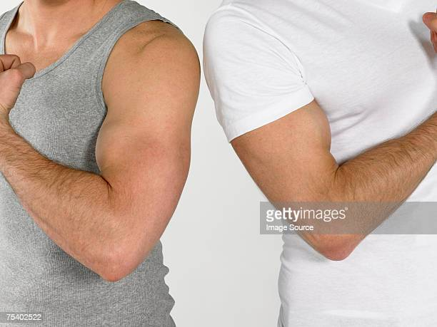 Men flexing muscles