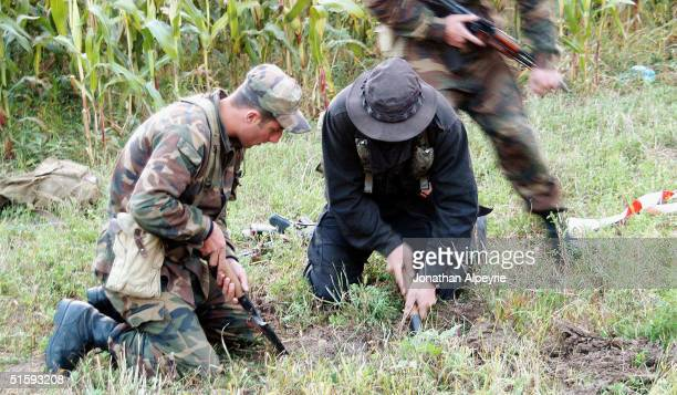 Men from A company are digging out an unexploded ordonnance shot by South Ossetian troops into a Georgian corn field on September 18 2004 in...