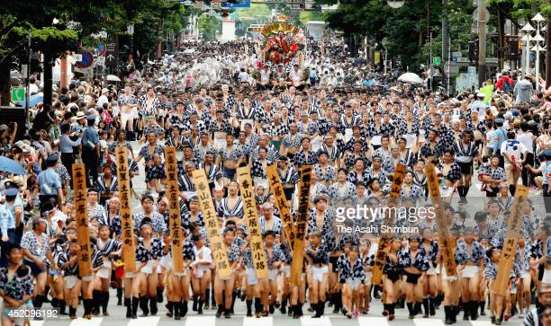 Men from all seven groups run with 'kakiyama' floats during the 'Shudan Yamamise' as a part of the Hakata Gion Yamakasa festival on July 13 2014 in...