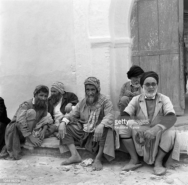 Men from Djerba's Jewish community seated before a porch in Tunisia around 1970 Djerba's Jewish community is one of the oldest in North Africa
