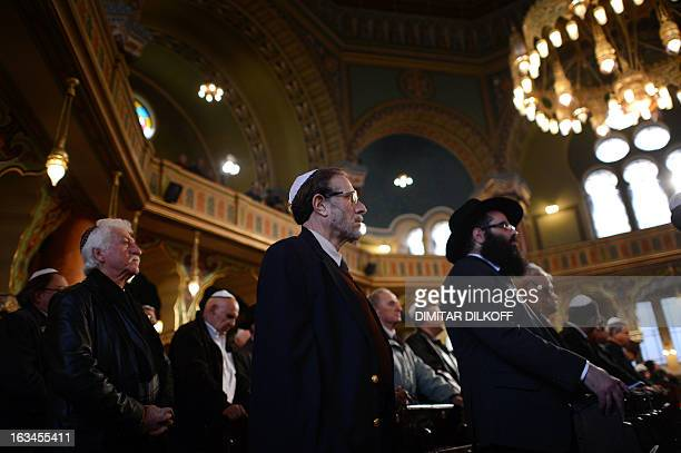 Men from the Bulgarian Jewish community pray during a commemoration ceremony at Sofia's synagogue on March 10 2013 Bulgaria's parliament for the...
