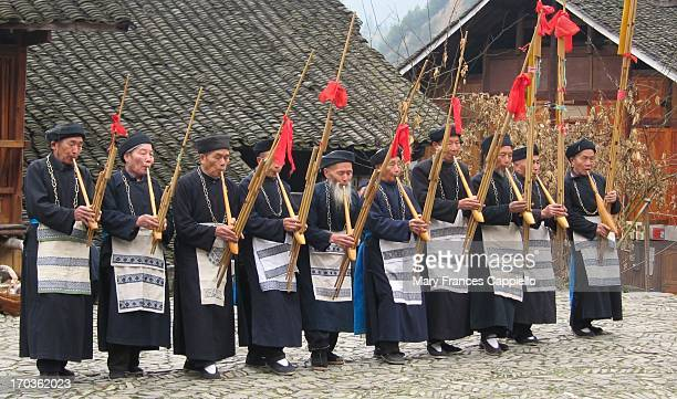CONTENT] Men from the Chinese Miao minority play the lusheng a kind of wind instrument that is the most important instrument in their culture I was...