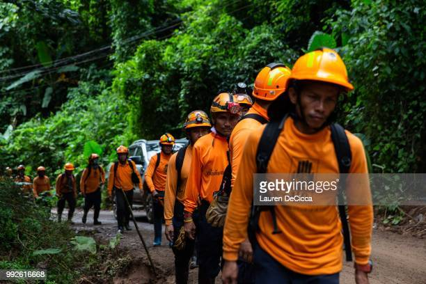 Men from the Department of Disaster Prevention and Mitigation arrive to the cave entrance on July 6 2018 in Chiang Rai Thailand The 12 boys and their...
