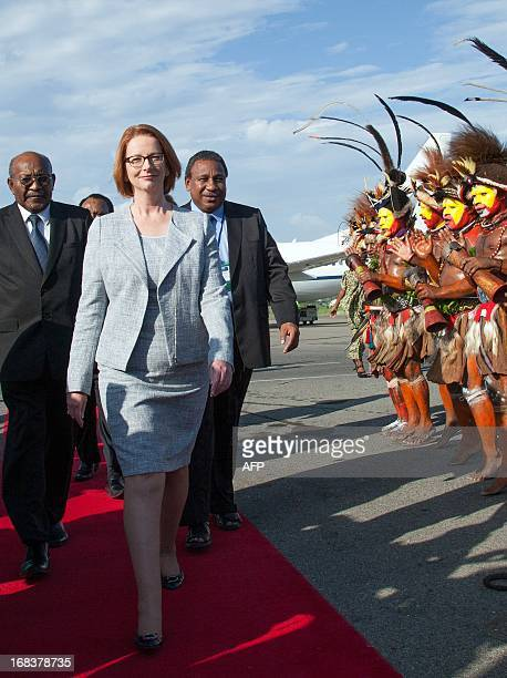 Men from the Huli Wigmen tribe welcome Australian Prime Minister Julia Gillard in their traditional way upon her arrival in Port Moresby Papua New...