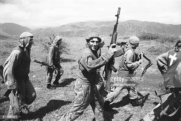 Men from the intelingence squads of the NKR Defense Army's 8th regiment carry AK-74's in a show of force along the front line April 27, 2004 in...