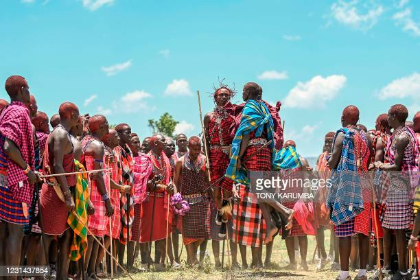 Men from the Kenyan Maasai tribe perform a traditional jumping-ritual among fellow members of a common age-set as they observe a rite of passage to...