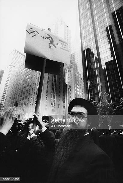 Men from the Satmar Hasidic sect carry antiIsrael placards at a demonstration in New York City circa 1984