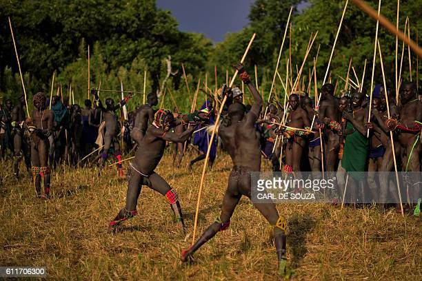 Men from the Suri tribe take part in a 'Donga' or stick fight in Ethiopia's southern Omo Valley region near Kibbish on September 24 2016...