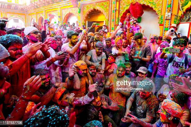 Men gather and pray during the celebration of the Holi festival on March 21 2019 in Mathura India