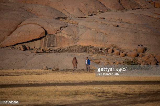 """Men gather at the """"koppie"""", close to the Lonmin owned mine, now controlled by Sibanye Stillwater, in Marikana, Rustenberg, where striking miners were..."""