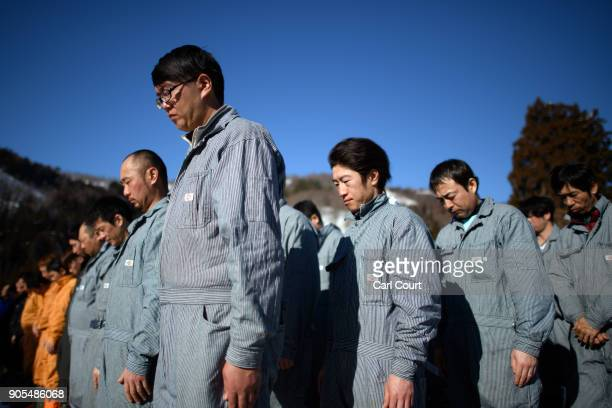 Men gather for a brief ceremony as construction of the shrine is completed during preparations for the Nozawaonsen Dosojin Fire Festival on January...