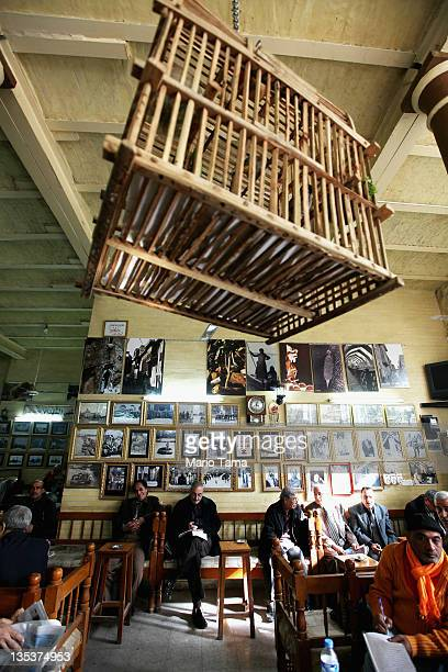 Men gather in a tea shop beneath a bird cage in the old quarter on December 9 2011 in Baghdad Iraq Iraq is transitioning nearly nine years after the...