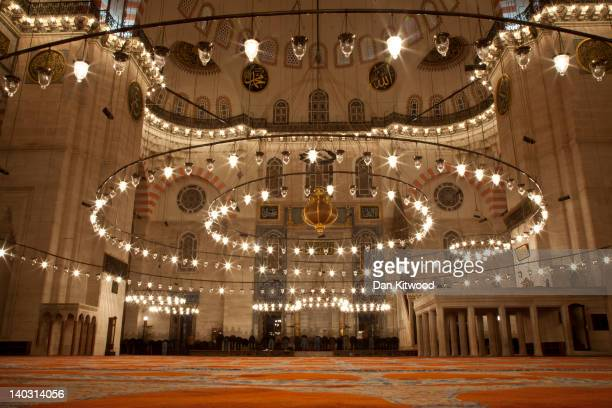 Men gather to pray inside the Suleymaniye Mosque on February 21 2012 in Istanbul Turkey Though not the capital Istanbul is the cultural economic and...
