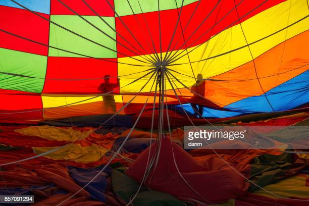 Men gathering the balloon after landing in Cappadocia, Turkey