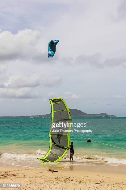 Men Get Their Colorful Kiteboard Sails Ready on the Beach to Head Out Into the Water for Some Kiteboarding in the Pacific Ocean With The Mokapu...