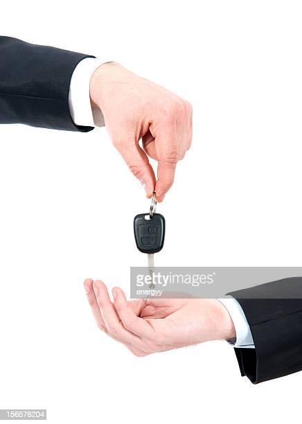 men gives car key