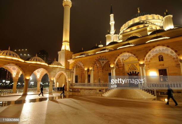 Men go to pray early on March 10 2011 in the Heart of Chechnya mosque dedicated to late Chechen President Ahmad Kadyrov father of the current leader...