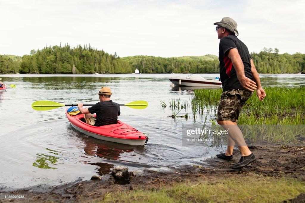50 + men going kayaking on a lake. : Stock Photo