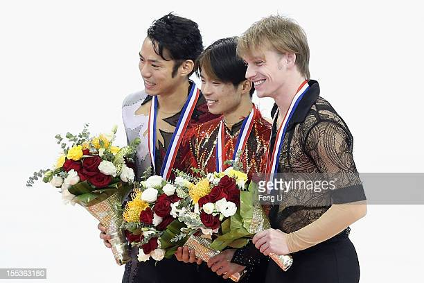 Men gold medalist Tatsuki Machida of Japan silver medalist Daisuke Takahashi of Japan and bronze medalist Sergey Voronov of Russia pose for photo...