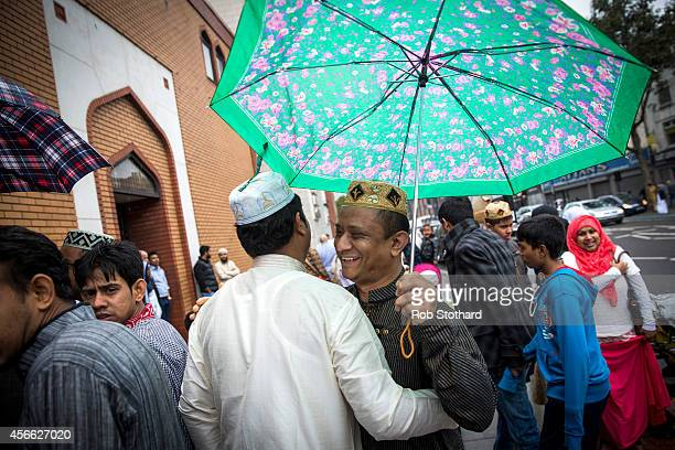 Men greet each other outside the East London Mosque before Eid AlAdha prayers on October 4 2014 in London England Muslims around the world are...