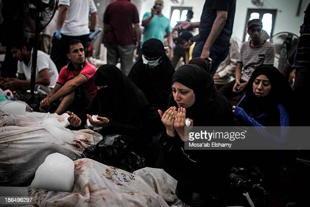 CONTENT] Men grieve next to dead bodies of Morsi supporters at Iman mosque which was turned into a makeshift morgue following the violent dispersal...
