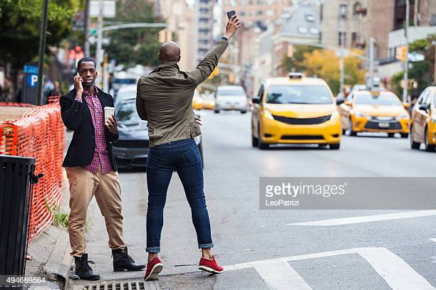 Men hailing a taxi in New York
