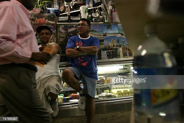 Men hang out in a bodega grocery store around the corner from where Bolivar Cruz was killed while working at his bodega last week June 18 2007 in the...