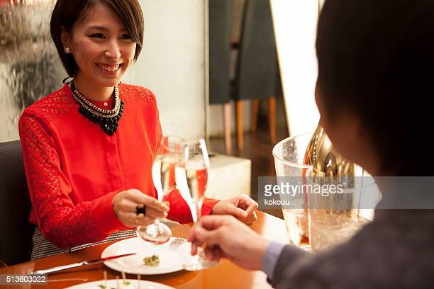 Men have a meal with her boyfriend at a restaurant