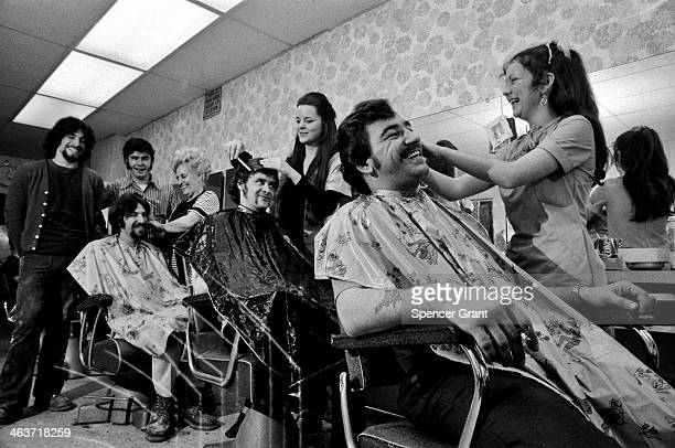 Men have a salon haircut South Boston Massachusetts 1971