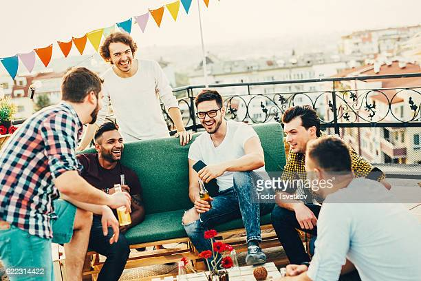 Men having a party on the roof