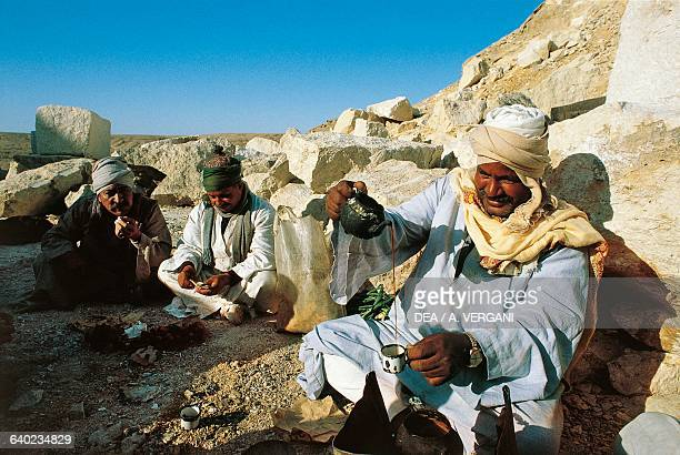 Men having a tea break in a stone quarry Zawyet el'Aryan Sinai Egypt
