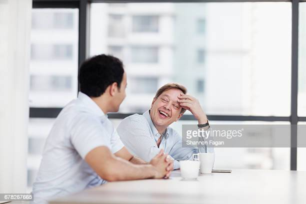 Men having casual conversation in coffee lounge
