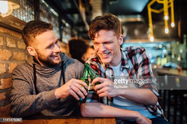 men having celebratory toast - lotterytickets stock pictures, royalty-free photos & images