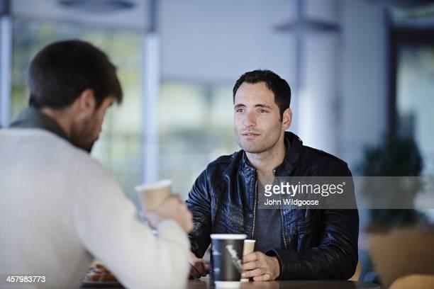 Men having coffee in cafe