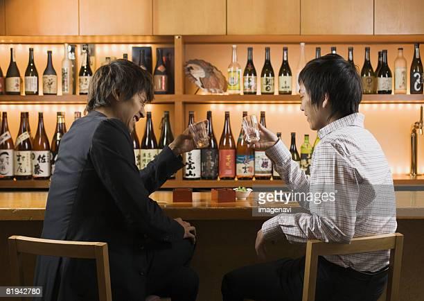 Men Having Drinks in Japanese Style Pub