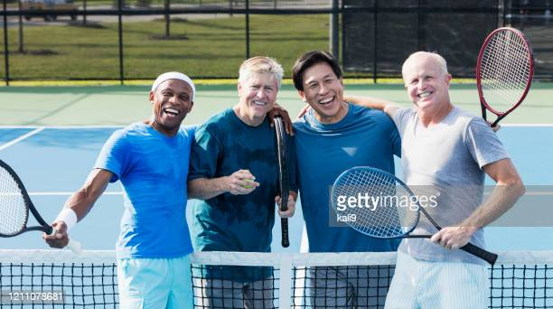 men having fun playing tennis - doubles sports competition format stock pictures, royalty-free photos & images